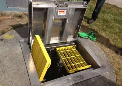"Sewage wet well access W/fall protection Set into place ""Foster City"" H-44 traffic Rated direct traffic hinged torsion assisted access City of Pittsburg  A Sidewalk ADA compliant access hatch with a clear opening of 66"" X 150"""