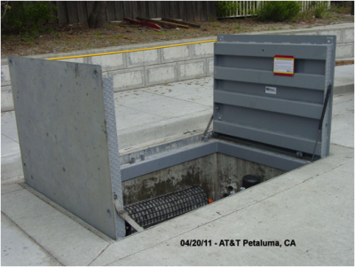 "AT&T communications dry utility vault in Petaluma Ca. Has continuous Traffic ""Starts & Stops"" of Transit busses. Abuse like this and what ""Truckee Donner Sanitation District"" says how well Vault access Solutions fixtures hold up to the snow plows vibrations separates us from others!"
