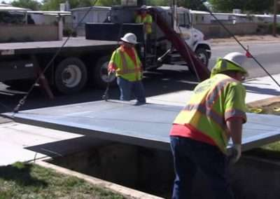 "Los Angeles County Public works Lancaster area setting a new access fixture of 12 1/2ft. long X 7ft. wide. See two minute ""Lancaster sidewalk"" video."